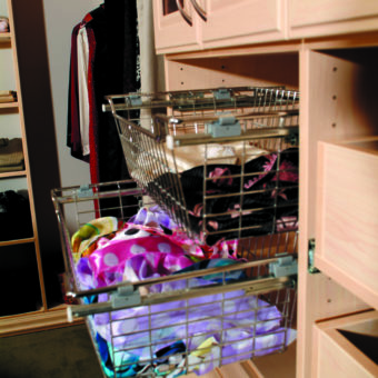 Pull out storage baskets in custom walk in bedroom closet