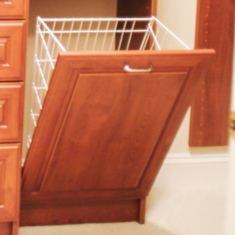 Pull out hidden hamper in built in unit of bedroom closet