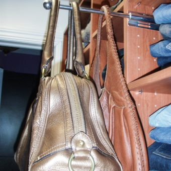 Valet rod with purses in walk in closet