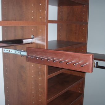 Custom pull out belt rack in bedroom closet