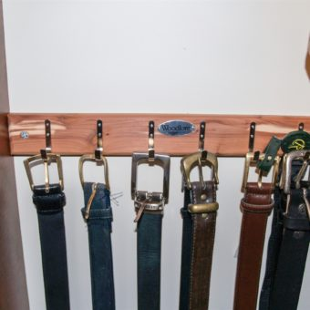 Hooks for belt storage mounted on wall