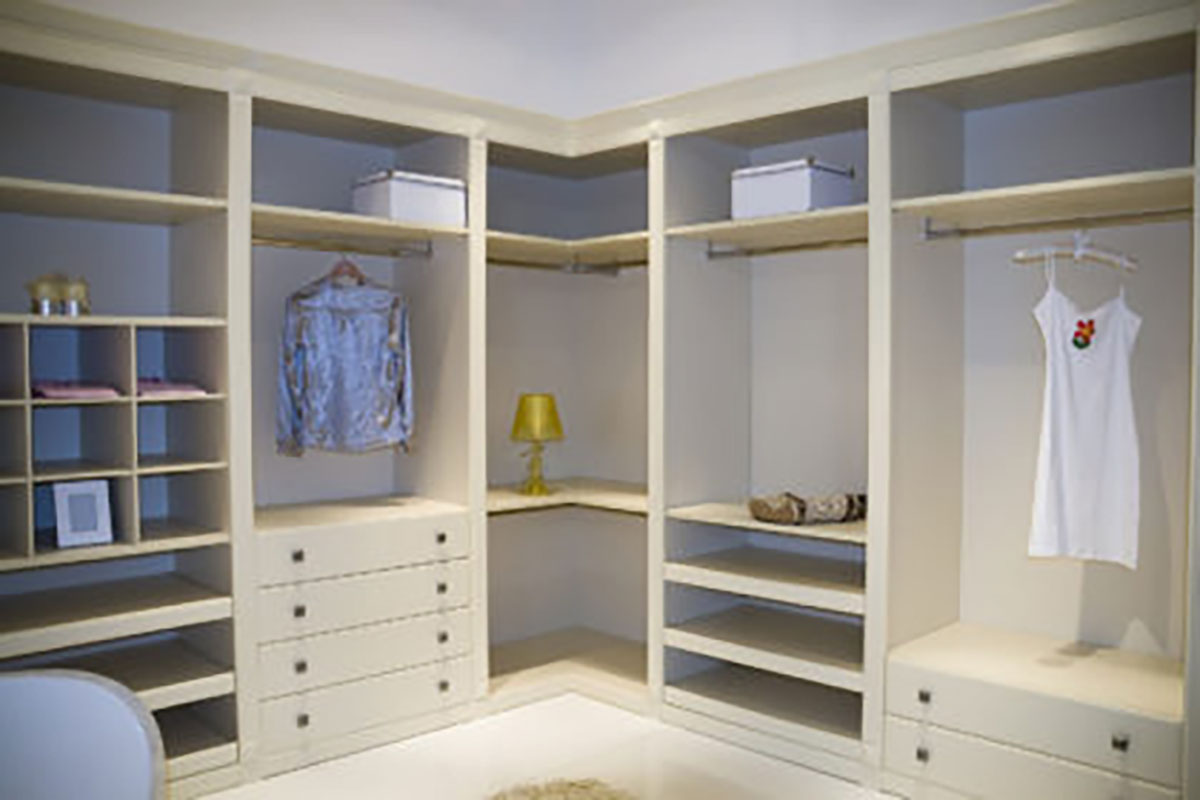 Custom built in white organizers and shelving in dressing room
