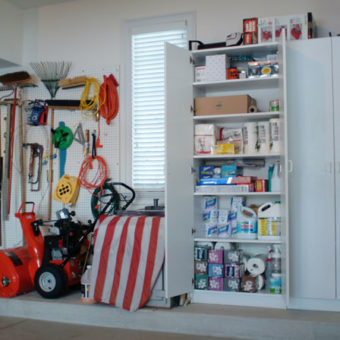 Built in large garage storage cabinets with open doors