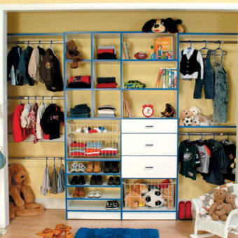 Built in custom reach-in closet shelving and hanging rods for kids' bedroom stuffed animals and toys