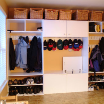 Wall hooks, shoe shelving, organizers, and under seat storage in mud room