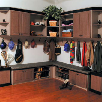 Cabinetry, under seat cubbies, wall hooks, and sports gear storage in mud room
