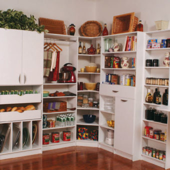 Built in pantry with pull out vegetable organizers, wine storage, shelving, and cabinets with folding prep area
