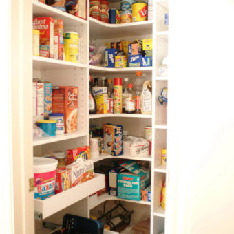 Custom wrap around built in shelving unit in small pantry