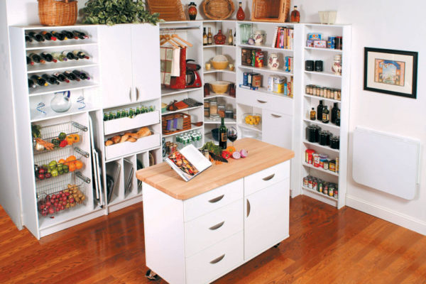 Custom kitchen storage and cupboard unit with shelving and drawers with a rolling island