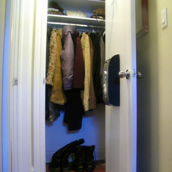 Shelving and hanging solution in small reach-in closet