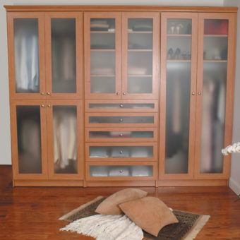 Large dual wardrobe with frosted glass doors and drawers in bedroom with closed doors