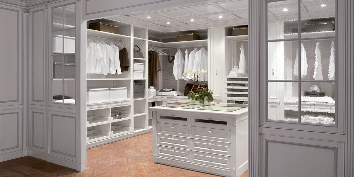 Large walk in bedroom closet pull out accessory organization, built in shelving, hanging rods, with windows and storage bins