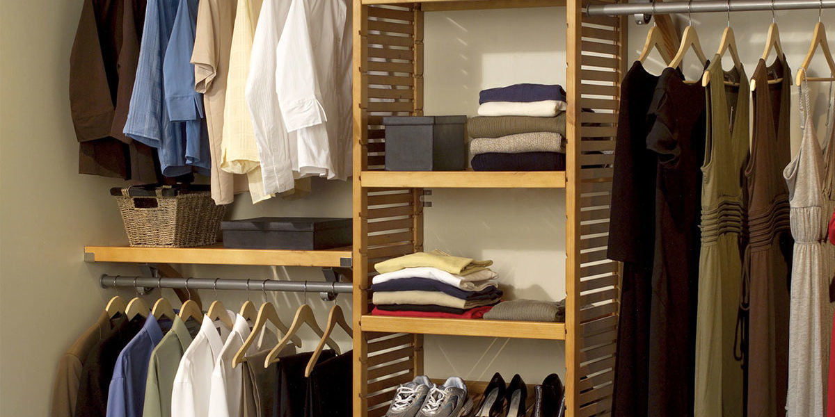 Built in wooden closet shelving and hanging rods