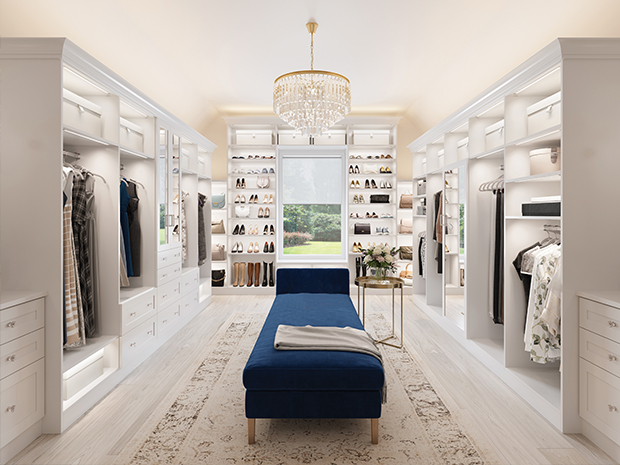 Large white walk in closet with a blue bench