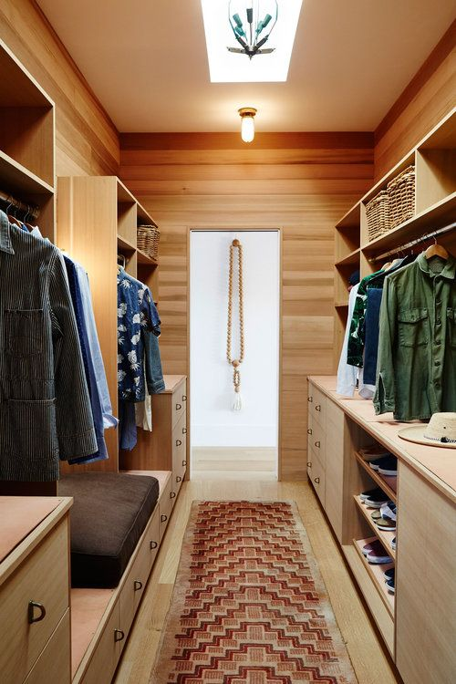 A wooden double sided walk in closet