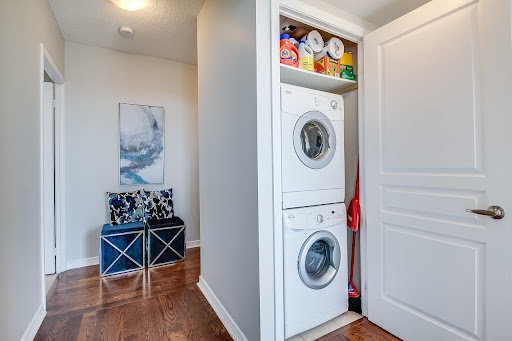 white stacked washer and dryer in a closet space