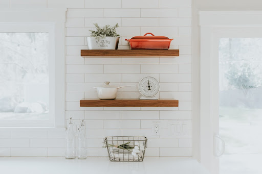 White tile background and wood shelves