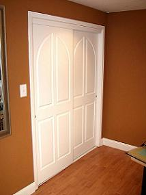White raised panel sliding doors
