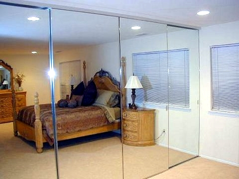 Sliding mirror closet doors in bedroom