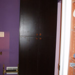 Black armoire with closed doors