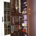 Black armoire with necklace and handbag storage