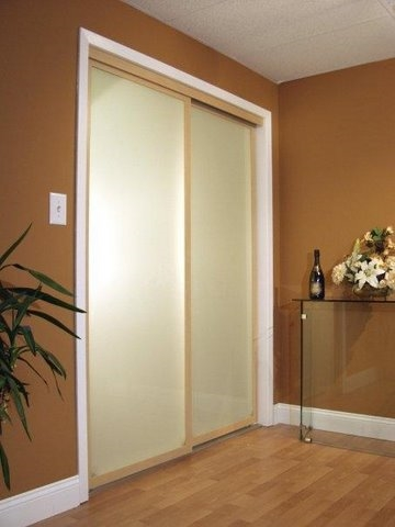 Maple sliding closet doors in hallway