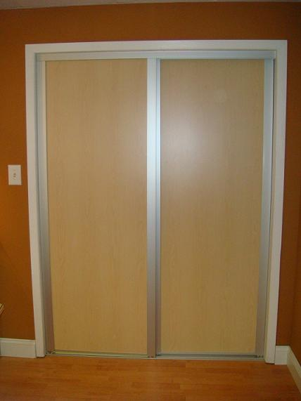 Sliding maple wooden closet doors with metal framing