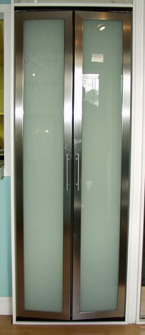Stainless steel pivot pantry door with white laminate inset