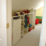 Built in wall unit under interior eave for child's storage