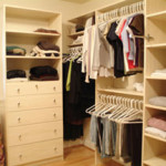 Walk in bedroom closet with shoe organizer, shelving, and hanging rods