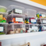 Children's toy storage with labeled clear containers